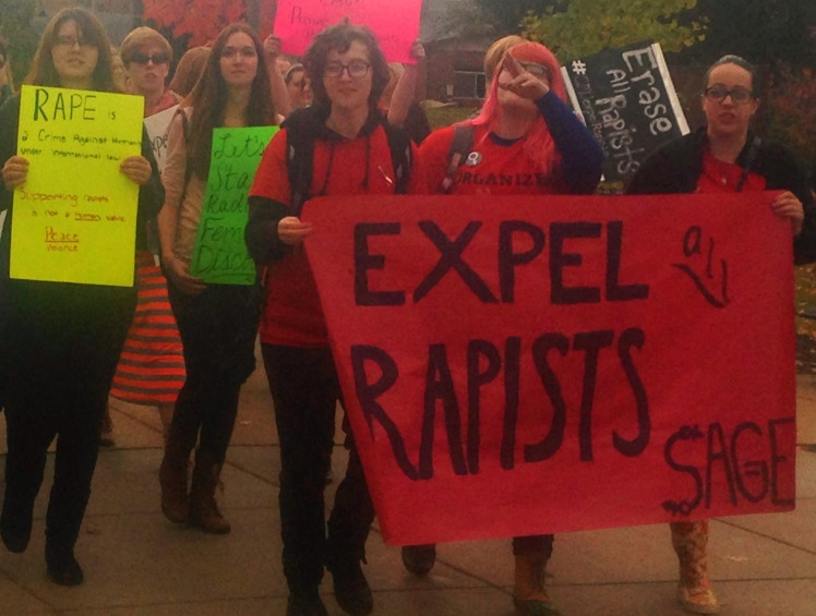 CMU students protest sexual assault policies on Oct. 28 2014. Left, Kai Niezgoda, center Hannah Mollett, right Marie Reimers.